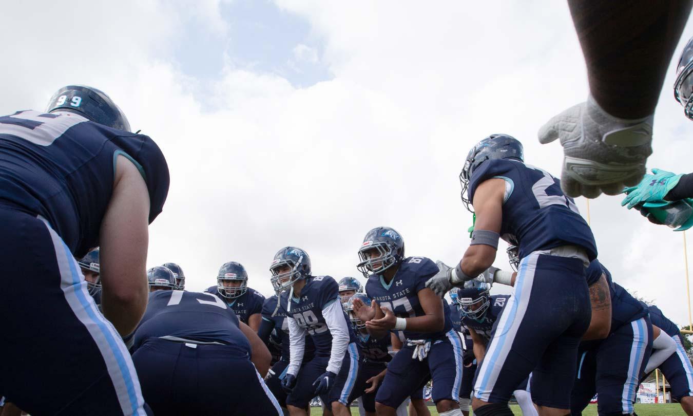 Dakota State Trojan Football team rallying before the homecoming game.