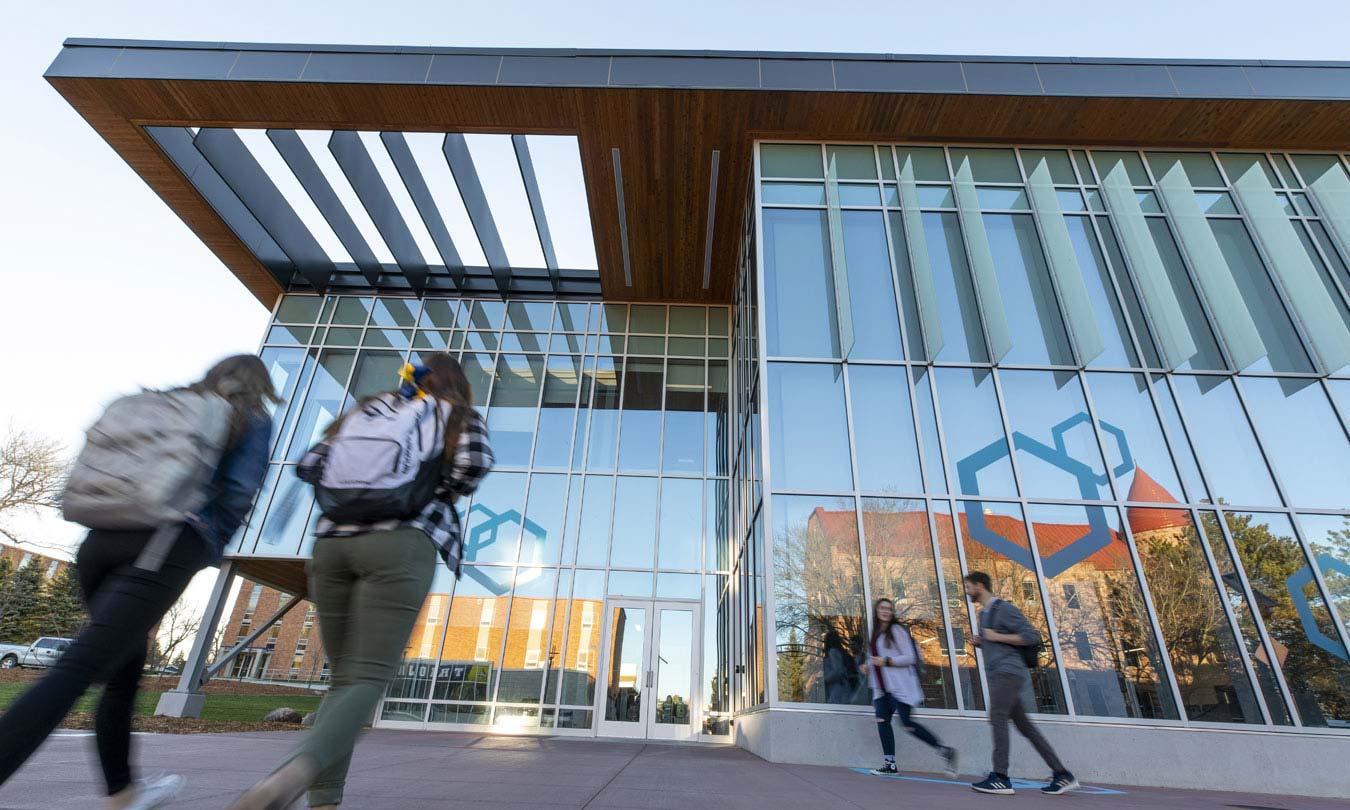 Students walking across DSU's campus