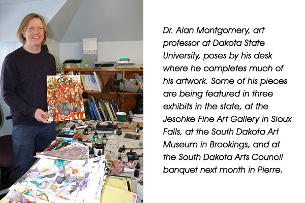 WORK STATION – Dr. Alan Montgomery, art professor at Dakota State University, poses by his desk where he completes much of his artwork. Some of his pieces are being featured in three exhibits in the state, at the Jeschke Fine Art Gallery in Sioux Falls, at the South Dakota Art Museum in Brookings, and at the South Dakota Arts Council banquet next month in Pierre.