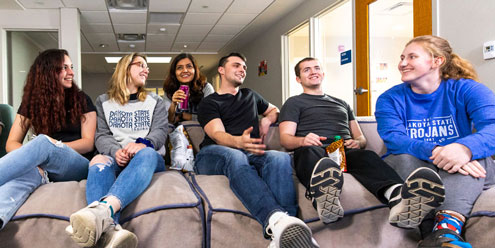 students sitting on couch